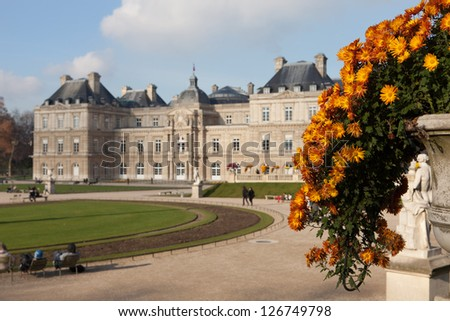The Luxembourg Palace in Paris, France - Selective focus on flowers - stock photo
