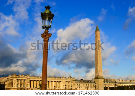 The Luxor Obelisk and streetlight on the Place de La Concorde in Paris, France. Dramatic sky lighting. - stock photo