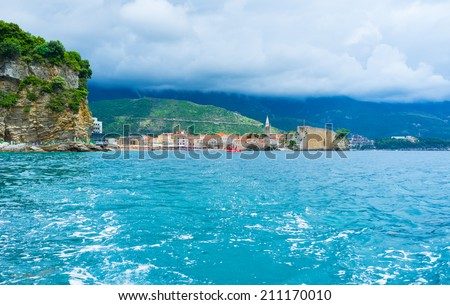 The luxury resort of Montenegro boasts one of the best preserved fortresses, comfortable sand beaches and promenade along the rocky coastline, Budva. - stock photo