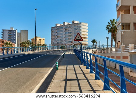 The 53 m long Bascule bridge of La Manga (La Manga del Mar Menor), in summer timetable it raises eight times a day. Region of Murcia, Spain.