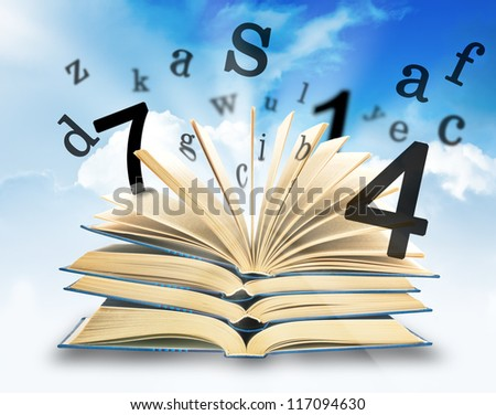 The Magic Book and the letters on a sky background. Education concept