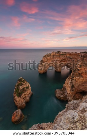 The magical landscape sunset beach Marinha in Portugal. - stock photo