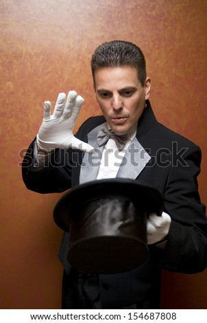 The magician holding top hat - stock photo