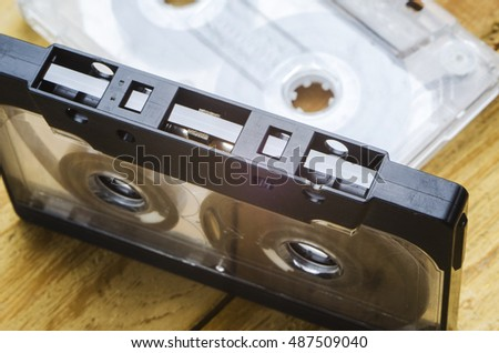 the magnetic cartridge for the tape recorder on a wooden table