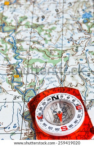 The magnetic compass and topographic map. Travel compass and map symbols adventures. - stock photo