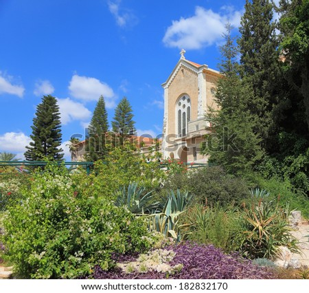 The magnificent building of the temple is surrounded by a lush garden. The famous Trappist monastery - Latrun - stock photo