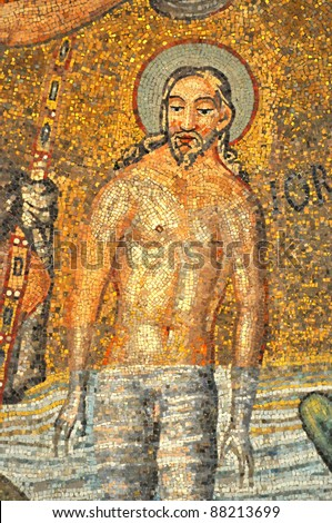 The magnificent mosaic of the baptism of Jesus Christ in the river Jordan. From the UNESCO listed Neonian  baptistry ceiling, Ravenna, Italy