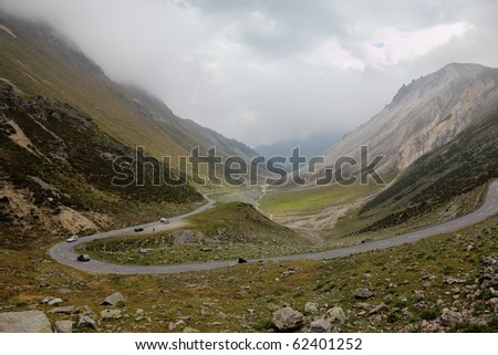 The magnificent mountain valley. Winding and dangerous road - the Serpentine. Photo taken by lens Fisheye - stock photo