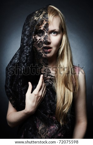 The magnificent mysterious young woman under a veil - stock photo