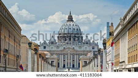 The magnificent view on St. Peter's Basilica in Rome by the Via della Conciliazione - stock photo