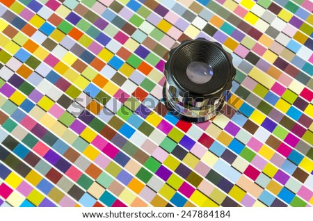 The magnifying glass standing on a leaf of the test print, top view - stock photo