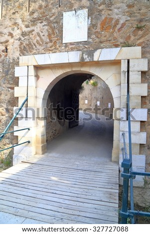 The main access gate to the medieval fortress in Saint Tropez, French Riviera, France - stock photo