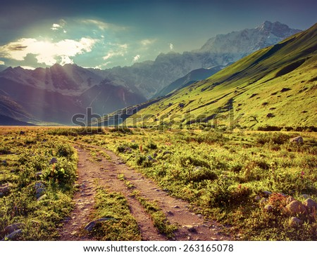 The main Caucasian ridge, Shkhara mountain. The view from the Ushguli village. Georgia, Upper Svaneti. Retro style. - stock photo
