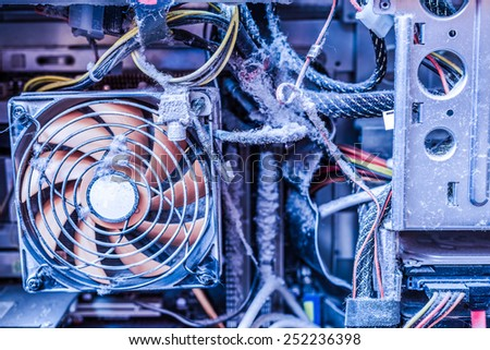 The main components of the outdated, dusty and non-working computer, clogged CPU fan. In blue tones - stock photo