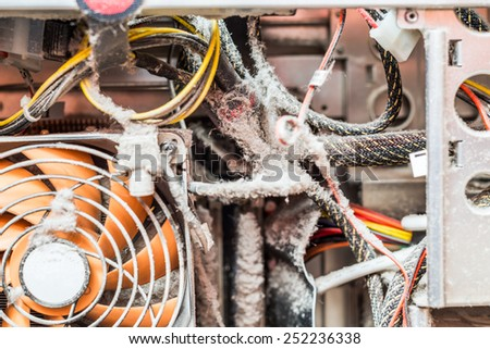 The main components of the outdated, dusty and non-working computer, supply and data cables in dust - stock photo