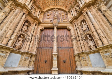 The main entrance and artwork of the Cathedral of Santa Maria of Palma de Majorca - stock photo