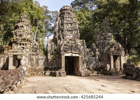 The main entrance to the Preah Khan temple near Angkor Wat in Cambodia consists of three towers.