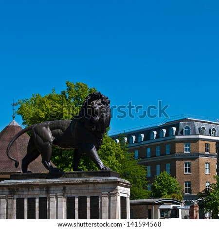The Maiwand Lion at Forbury Gardens in Reading, England (square crop, plenty copy-space on blue sky) - stock photo