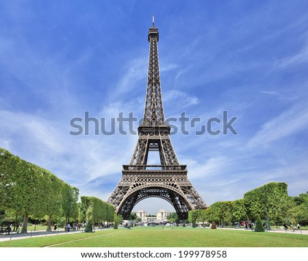 The majestic Eiffel tower in Paris against a blue sky - stock photo