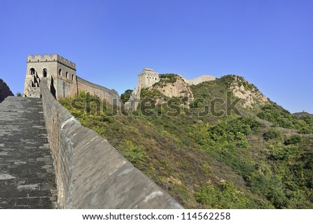 The majestic Great Wall against a blue sky at Jinshanling, 120 KM northeast from Beijing. - stock photo
