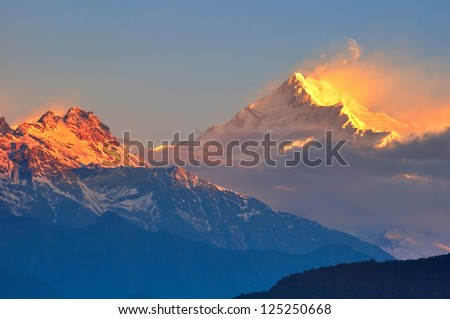 The majestic Kanchendzonga range of the himalayas at first light of sunrise - stock photo