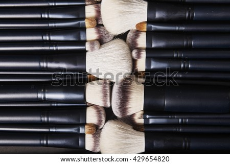 The makeup brush products on background - stock photo