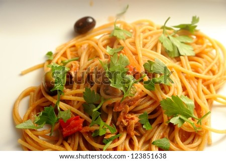 The making of a typical italian receipt, spaghetti with puttanesca sauce