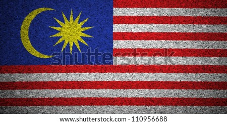 The Malaysia flag painted on a cork board. - stock photo