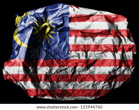 The Malaysia flag  painted on crumpled paper on black background - stock photo