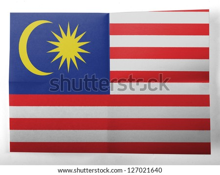 The Malaysia flag  painted on simple paper sheet - stock photo