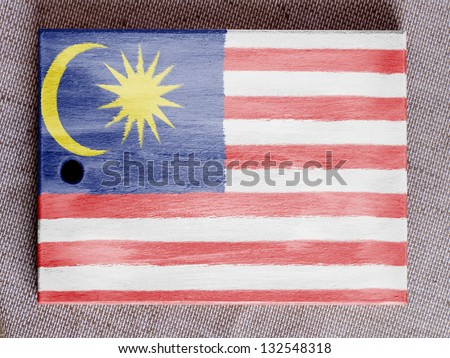 The Malaysia flag  painted over wooden board - stock photo