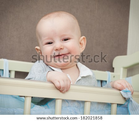 the male baby costs in a bed and smiles