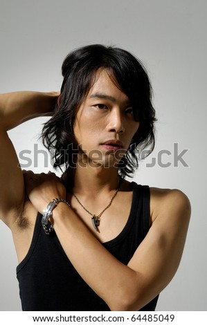 The male body isolated on gray background. - stock photo
