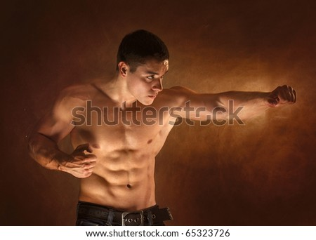 The male body on black