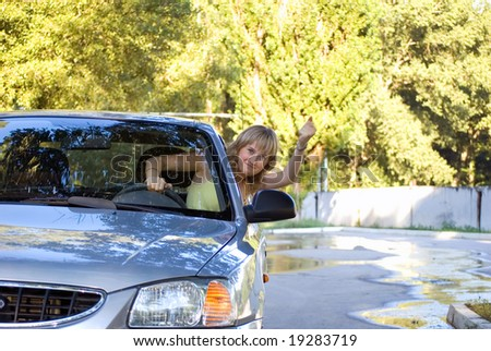 The malicious girl-driver threatens with a hand - stock photo