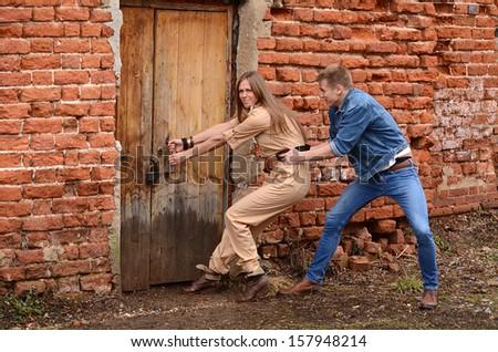 The man and woman open wooden door - stock photo