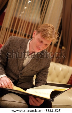 The man choosing a drink at the hotel restaurant - stock photo