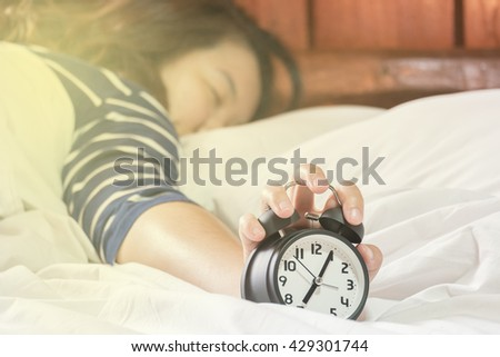 The man did not want to get out of bed because the alarm clock in the morning./made picture to the concept