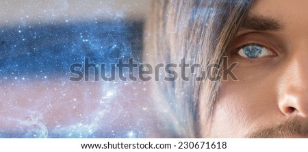 The man face with a reflection of the planet Earth in the pupil of the eye. Space technologies of the future. Male portrait on blue starry sky. The man eyes. Face close up. - stock photo
