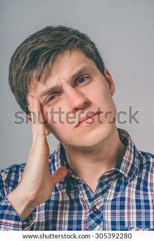the man has a pain in his temples - stock photo