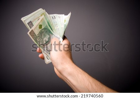 The man holding the hands of banknotes. Polish money