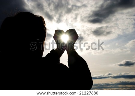 the man holding the sun in the hands - stock photo