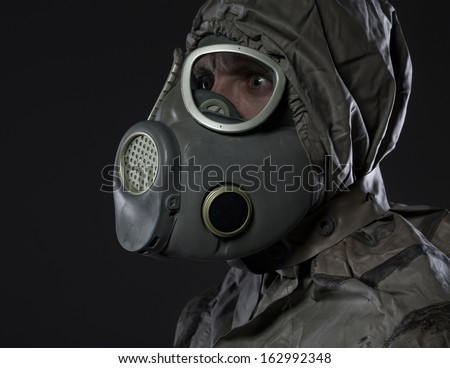 The man in a gas mask - stock photo