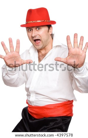 The man in a red hat. Dances  cha cha cha - stock photo