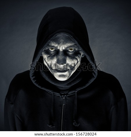 The man in an image of the monster on a black background - stock photo