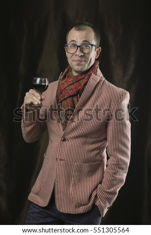 The man in glasses tasting red wine, emotions.