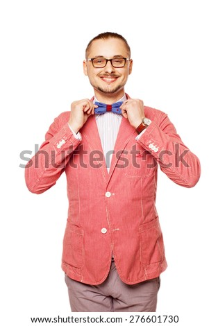 The man in pink jacket and blue bow tie on white background