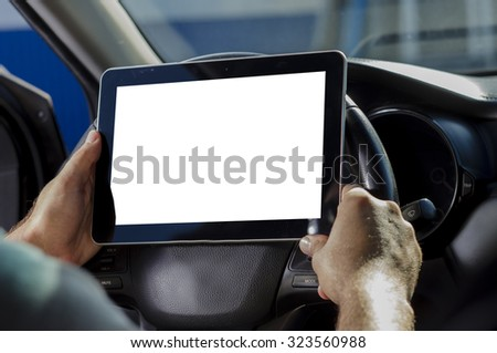 The man in the car, with the Tablet PC in hands