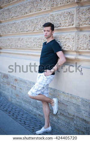 The man in the city in casual clothing lifestyle - stock photo