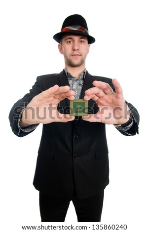 The man in the hat showing a microchip computer, shot in studio